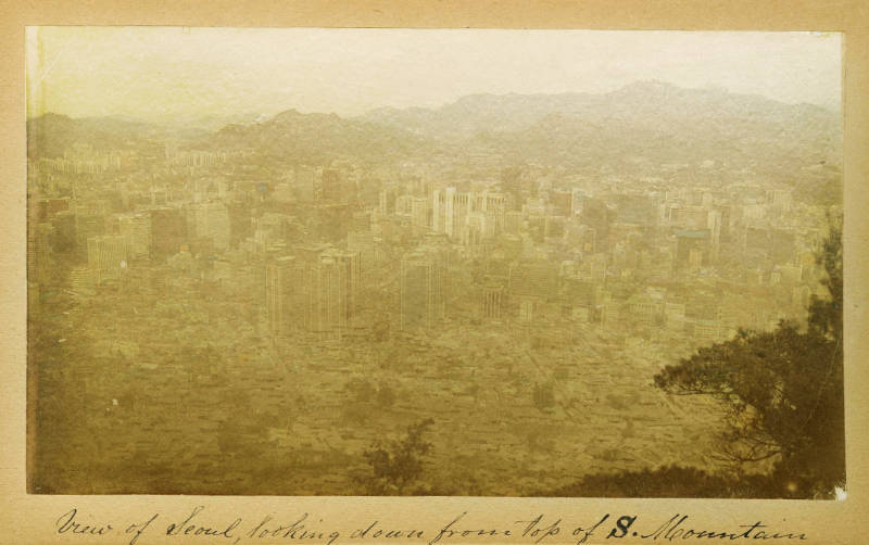 A remix of Faulk's aerial photo of Seoul from the late 19th century and a contemporary view of Seoul.